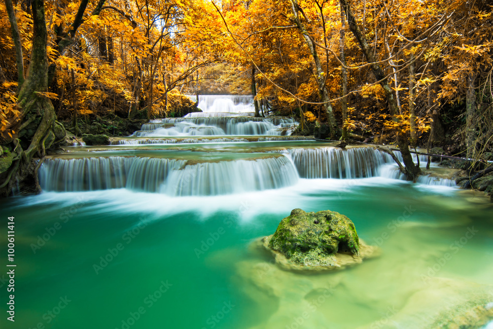 Fototapeta Beautiful waterfall in autumn forest