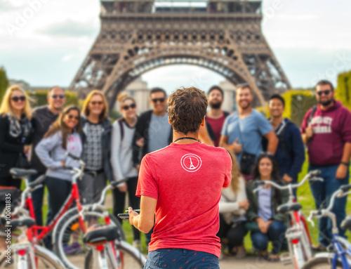 Photo  PARIS, FRANCE - AUGUST 30, 2015: Man photographs big group of tourists against Eiffel Tower in Paris