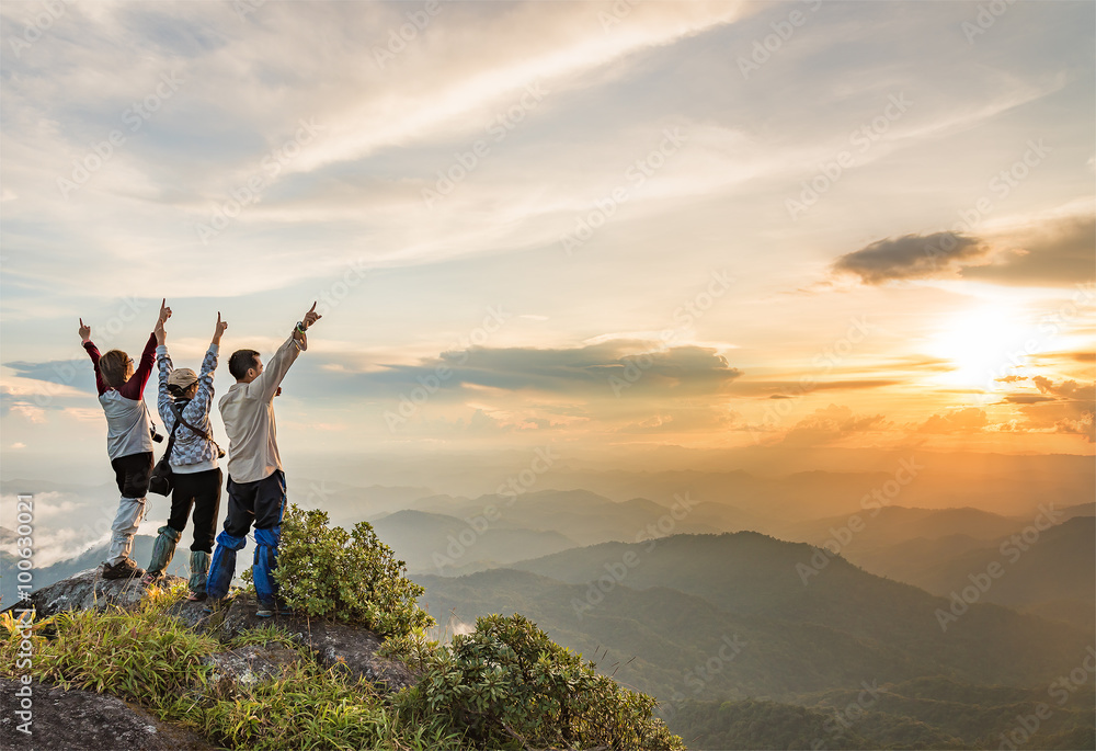 Fototapety, obrazy: Happy people on top of a mountain enjoying valley view while the sun is setting.