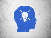 Education Concept: Head With Light Bulb On Wall Background