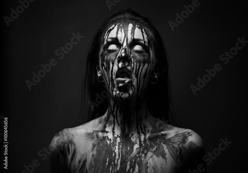 Photo female demon.Art studio shot.Goth girl with sliced tongue
