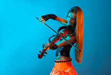 Young Female Violinist Playing...