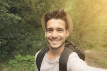 Handsome Guy Is Taking A Selfie With His Smartphone In The Nature - People, Technology And Lifestle Concept