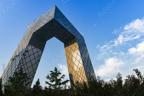 Tuinposter Peking BEIJING -July. 24: CCTV Headquarters at twilight on July. 24, 2014 in Beijing, The CCTV building is a loop of six horizontal and vertical sections with a total floor space of 473,000 square meters.