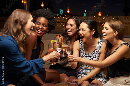 Fotografie, Obraz  Group Of Female Friends Enjoying Night Out At Rooftop Bar