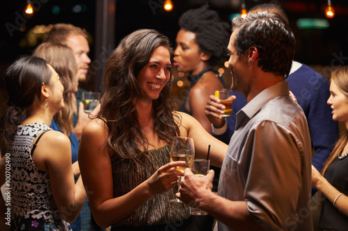 Couples Dancing And Drinking At Evening Party Poster