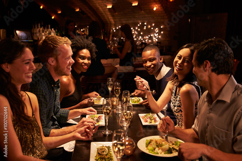 Recess Fitting Restaurant Group Of Friends Enjoying Meal In Restaurant