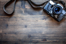 Old Retro Camera On Wooden Table Background