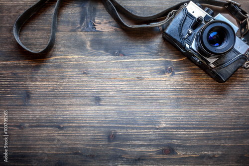 Old retro camera on wooden table background Canvas Print