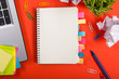 Leinwanddruck Bild - Office table desk with set of colorful supplies, white blank note pad, cup, pen, pc, crumpled paper, flower on red background. Top view and copy space for text