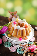 Naklejkaeaster almond ring cake on wooden table