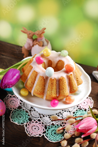 easter almond ring cake on wooden table - 100715232