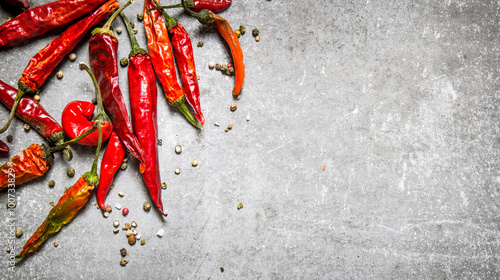 Poster Hot chili peppers Red chili pepper dried. On stone background.