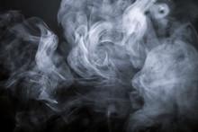 Smoke On A Black Background. Defocused. Toned