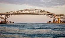 The Twin Spans Of The Blue Water Bridges Crossing Between Sarnia, Ontario And Port Huron, Michigan. This Is The Second Busiest Crossing US And Canada With The First Being The Windsor Tunnel.