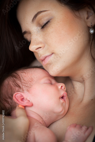 Portrait of a mother with her newborn baby