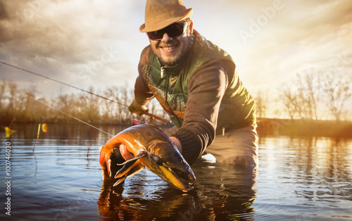 Happy angler with trout loach Canvas Print