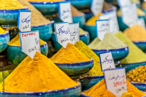 Fotografie, Obraz  Exposed spices with prices in the store on the Vakil Bazaar in the Shiraz city centre, Iran