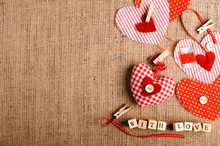 """Sewing Set: Fabrics, Threads, Pins, Buttons, Tape, Handmade Hearts, Words """"with Love"""" On Cubes, Burlap, Sackcloth Background. Retro Design Effects."""