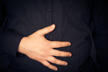 Young Man Suffering Abdominal Pain
