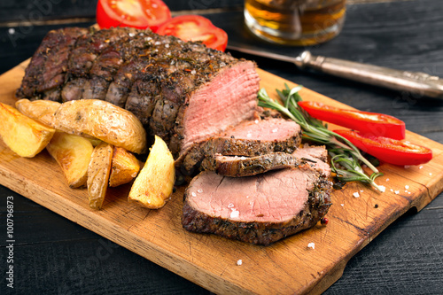 Fotografie, Obraz  Grilled beef on a cutting board