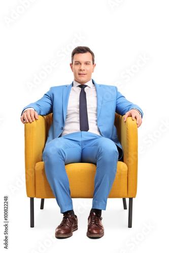 Fotografie, Obraz  Man in a blue suit sitting in an armchair