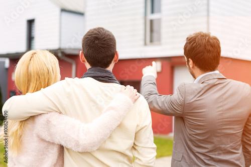 Fotografie, Obraz  Real estate agent shows details to customers