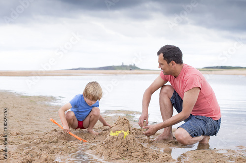Fotografie, Obraz  Playing on the beach with dad