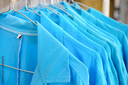 Valokuva  Blue Collar Jackets Hanging On A Line