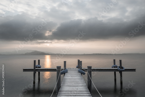 Fototapety, obrazy: Wooden pier on the lake. Fog. Sunset in pastel colors. Long exposure.