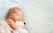 Leinwanddruck Bild - Cute newborn baby sleeps with toy teddy bear