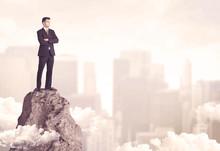 Confident Businessman On Dangerous Cliff