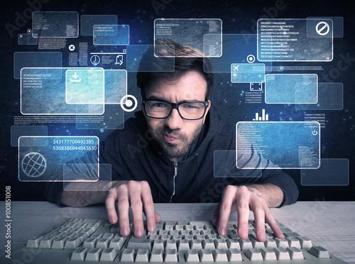 Nerd with glasses hacking websites