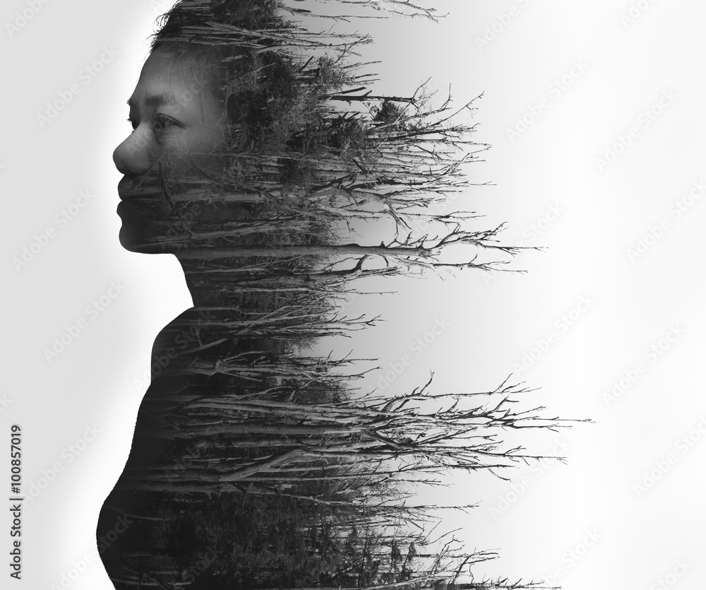 Fototapeta Double exposure portrait of young woman and dried forest