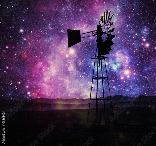 Foto op Aluminium Snoeien Landscape with windmill water pump Impession with stars on the sky