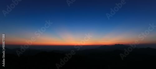 фотография  Panorama of colorful sky above mountain just before sunrise