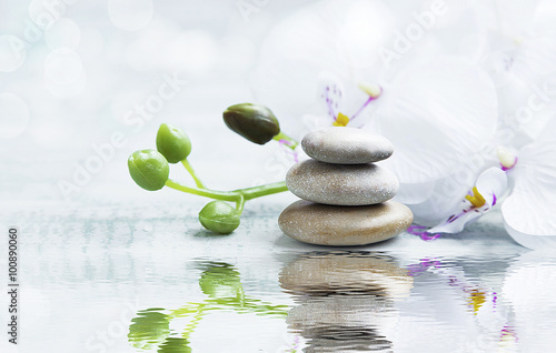 Foto-Fahne - Spa still life with stones, orchid on water reflection (von marrakeshh)