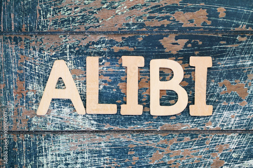 Word alibi written with wooden letters on rustic surface Canvas Print