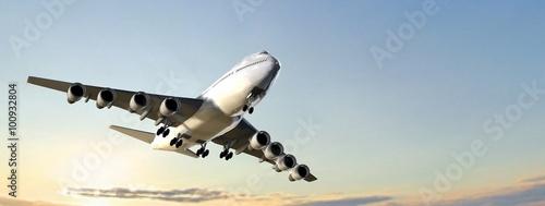 Foto Modern Passenger airplane flight in sunset