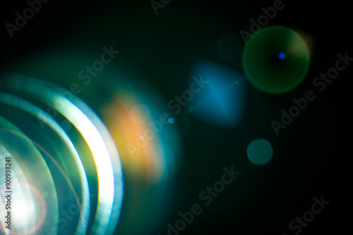Photo  Camera lens with lense reflections.