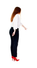 Back View Of Young Redhead Business Woman Pointing At Wall.