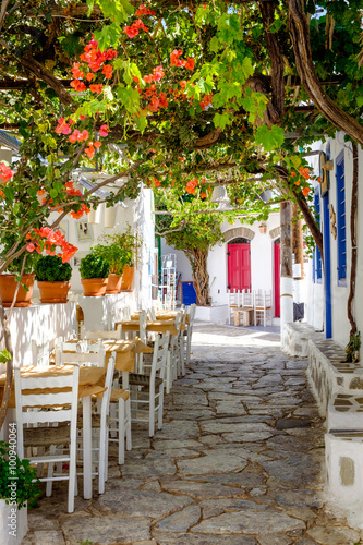 Beautiful mediterranean colorful street, Amorgos, Greece - 100940064