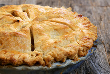 Delicious Whole Fresh Baked Rustic Apple Pie With Table Setting