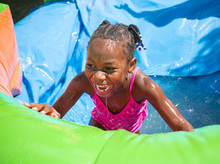 Smiling Little Girl Playing Ou...