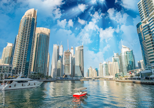 Buildings and skyline of Dubai Marina at dusk Poster