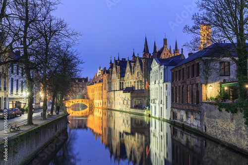City on the water Night scene of historic medieval buildings along a canal in Bruges