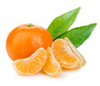 canvas print picture - Ripe mandarin with leaves close-up on a white background. Tangerine orange with leaves on a white background.