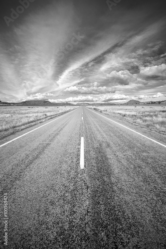 Black and white photo of a country road, USA.
