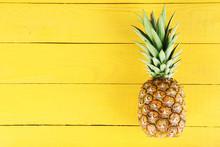 Ripe Pineapple On A Yellow Woo...