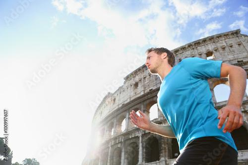 Running male runner jogging against Colosseum Wallpaper Mural